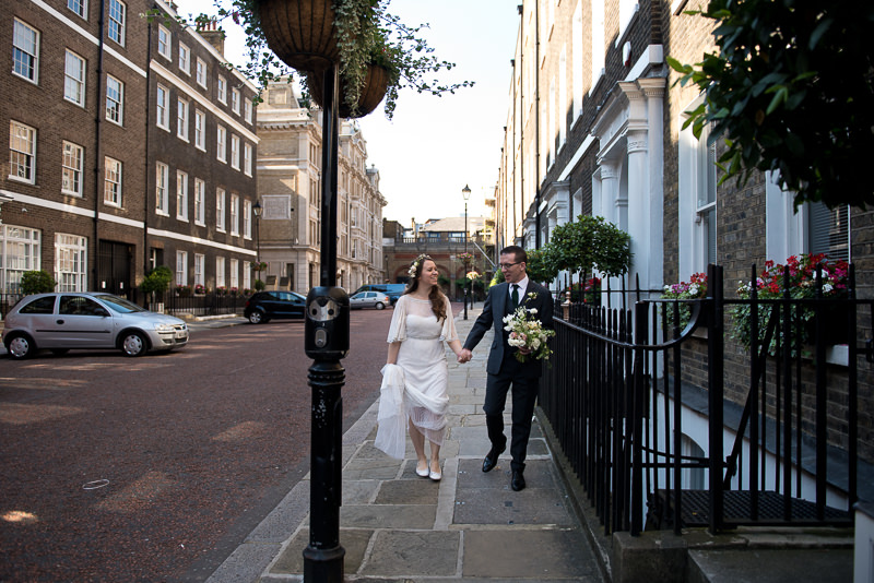 Bride and Groom outside St Etheldreda Church in London