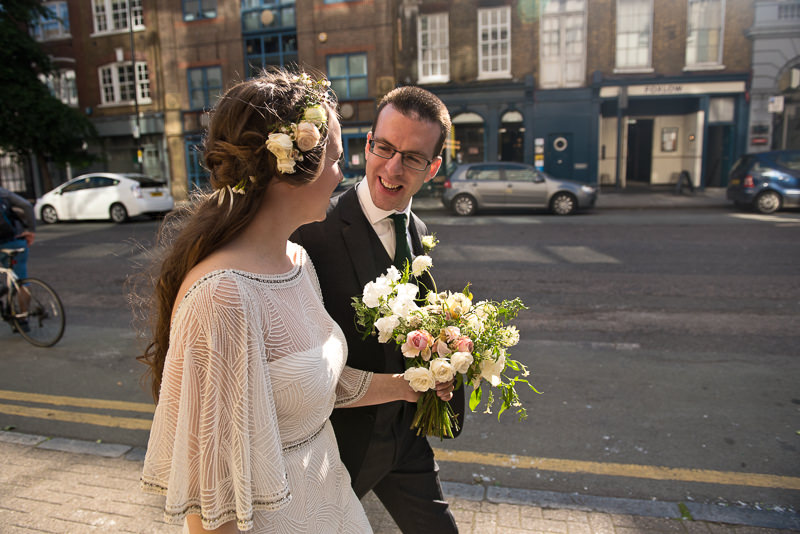 Bride and groom walk to wedding reception in Clerkenwell