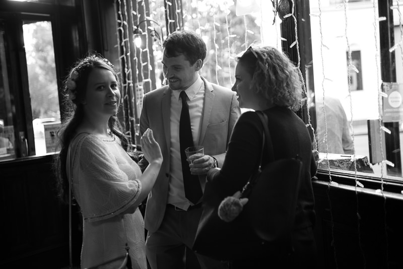 Bride mingles with guests at London pub wedding