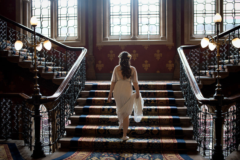 Bride on staircase at St Pancras Renaissance hotel