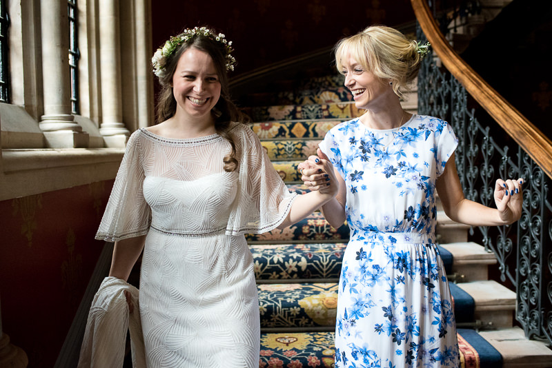Bride and sister on staircase of St Pancras Renaissance Hotel