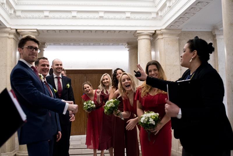 Birdesmaids and groomsmen cheer at Old Marylebone Town Hall