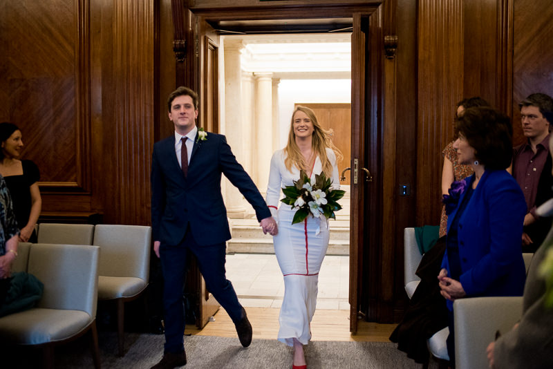 Bride and groom enter the room together at Old Marylebone Town Hall