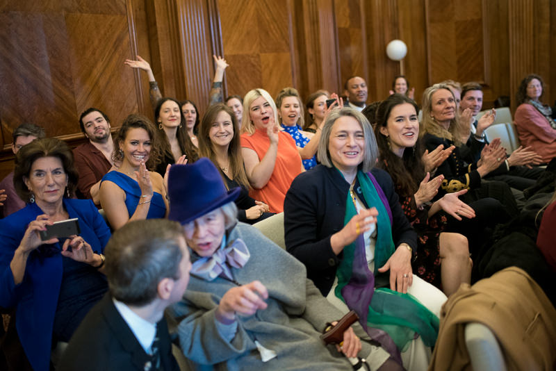 Guests cheer Old Marylebone Town Hall wedding