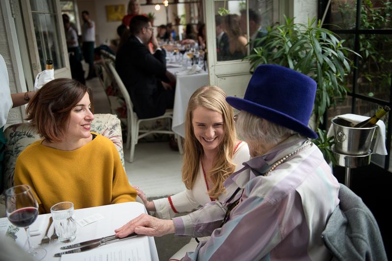 Bride talks to grandma at Bourne and Hollingsworth wedding