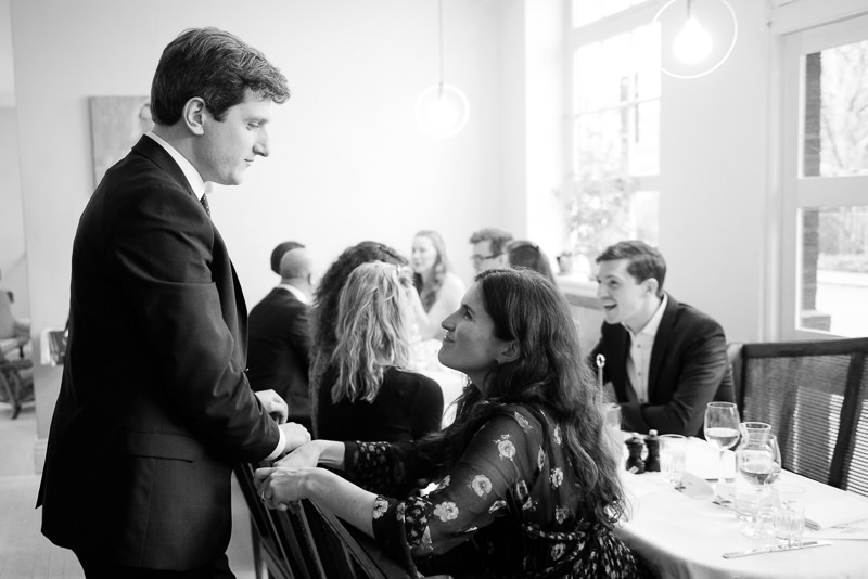 Groom mingles with guests