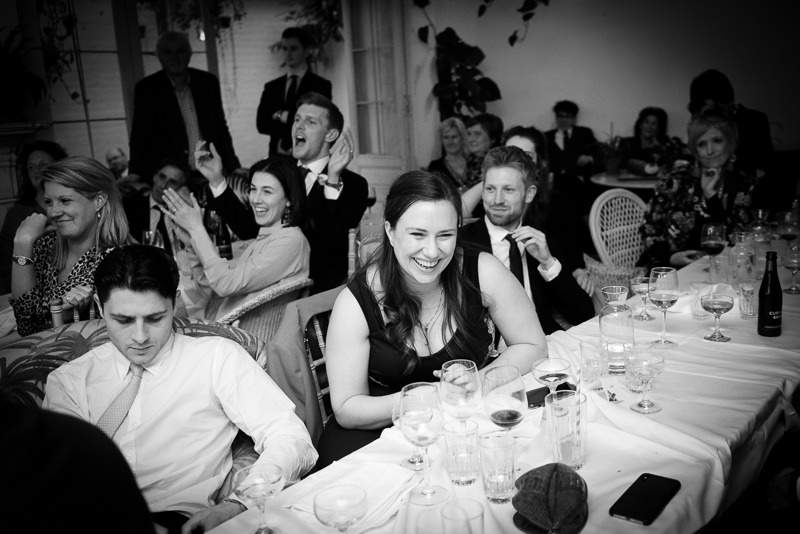 Guests enjoying themselves at wedding reception at Bourne and Hollingsworth