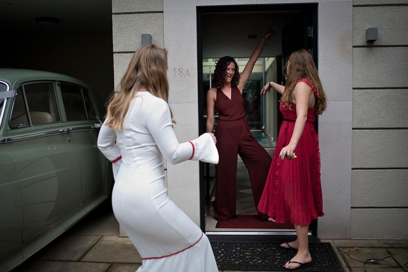 Bride dancing with her bridesmadis