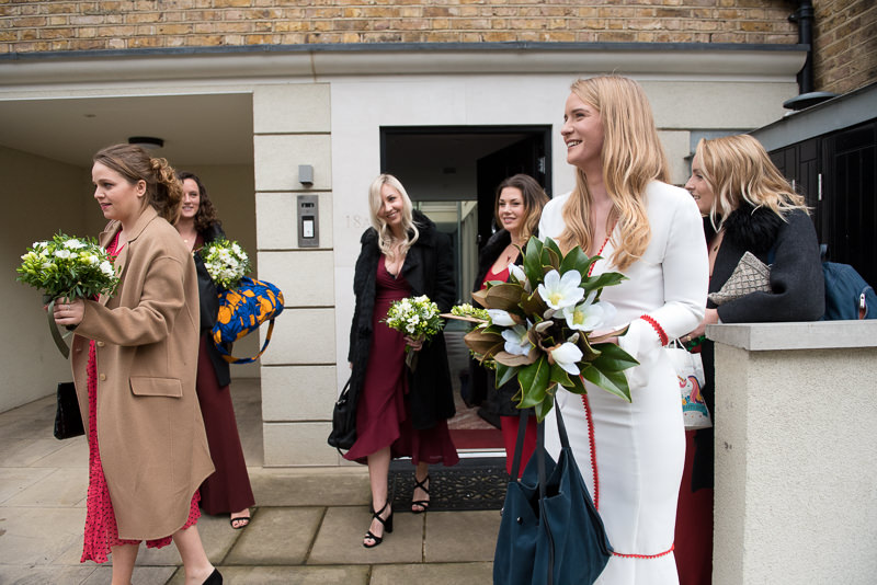 Bride and bridesmaids setting of for wedding at Marylebone Town Hall