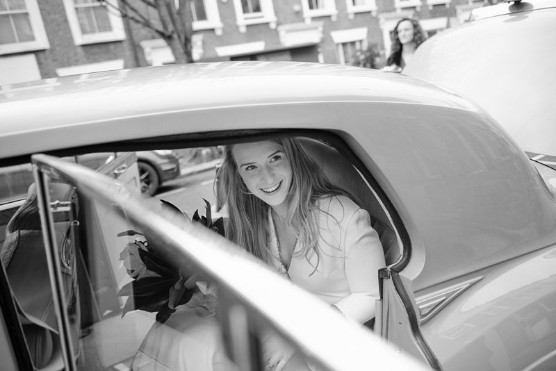 Bride in car on her way to wedding at Marylebone Town Hall