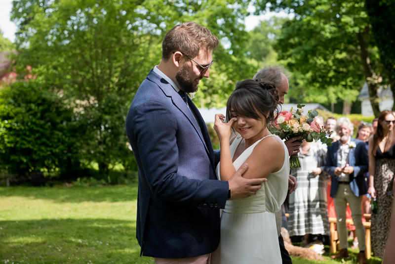 Bride cries at outdoor wedding in Kent