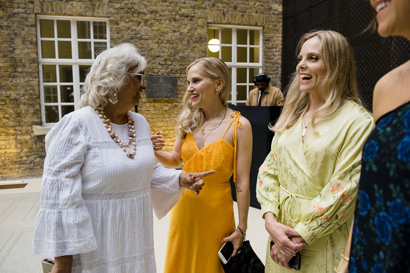 Bride mingles with guests at Hackney Town Hall