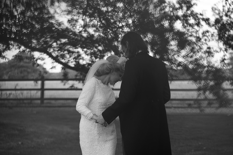 Moody black and white portrait of bride and groom at Walkern Hall wedding
