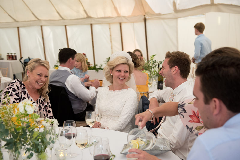 Bride chats to guests at Walkern Hall wedding