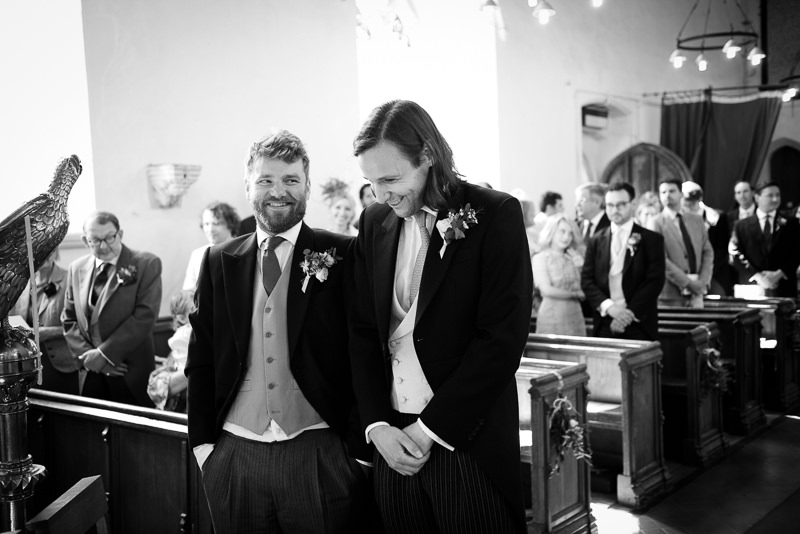 Groom waits for bride to walk up the aisle at St Peter's Church