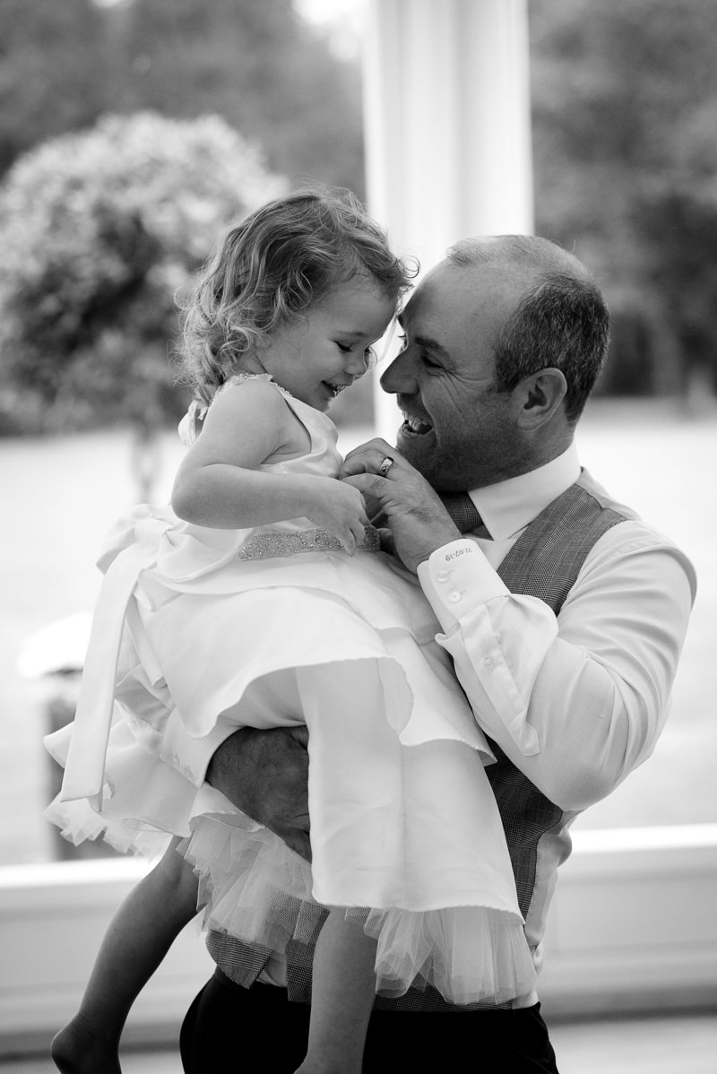 Groom with daughter captured by Boreham House wedding photographer