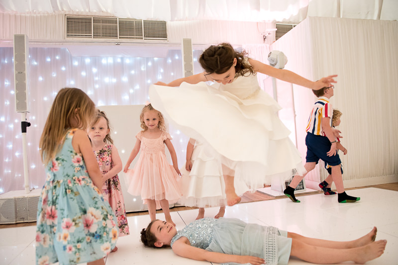 Kids play on the dancefloor at Boreham house wedding
