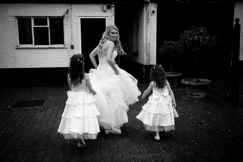 Bride with daughters photographed by Boreham house wedding photographer