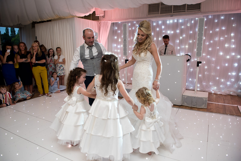 Bride and groom dance with their children at Boreham House wedding