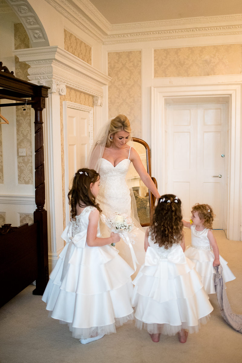 Bride in her dress with daughters taken by Boreham House Wedding Photographer