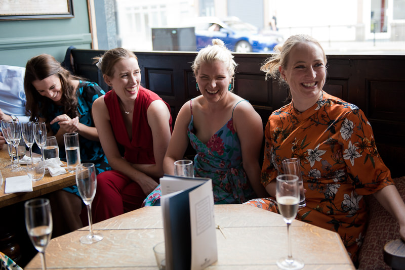 Brides' best friends giggle at Bull and Gate Kentish Town wedding