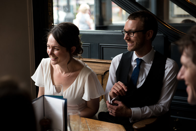 Natural photograph of bride and groom laughing at The Bull and Gate Kentish town