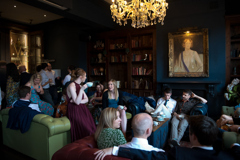 Wedding guests relaxing in the Boulogne Bar The Bull and Gate