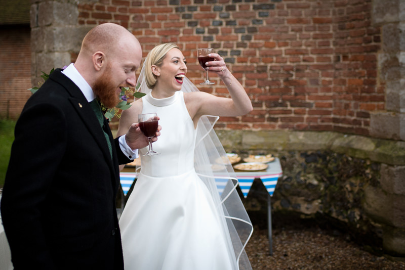 Bride and groom drink mulled wine at Christmas wedding