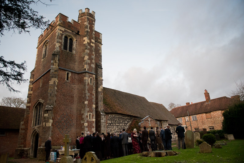 Wedding guests gather outside Church of St James the Less in Dorney Reach