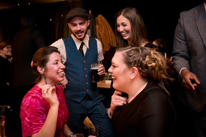 Guests have fun in marquee Christmas wedding