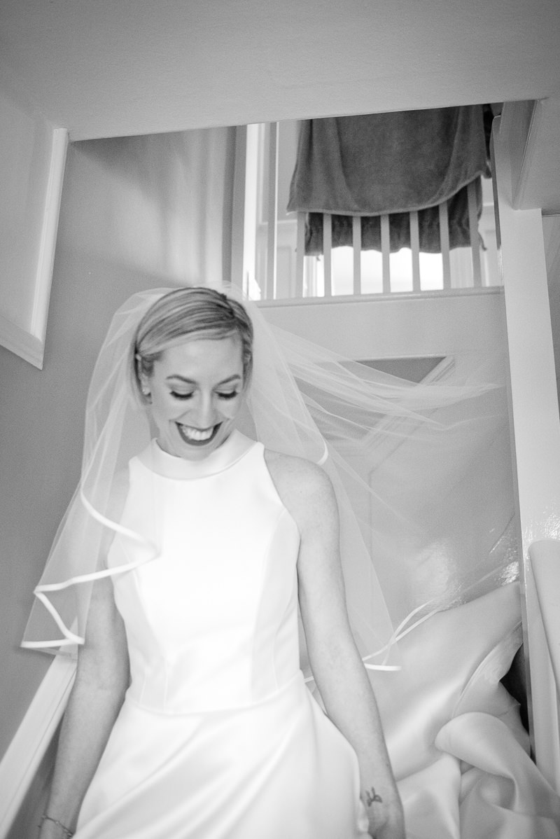 Bride walking down the stairs in family home