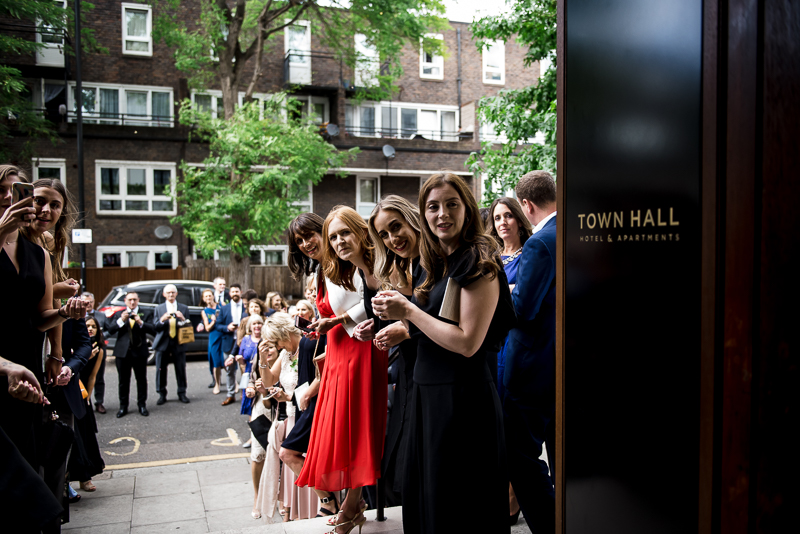 Guests wait to throw confetti at Town Hall Hotel