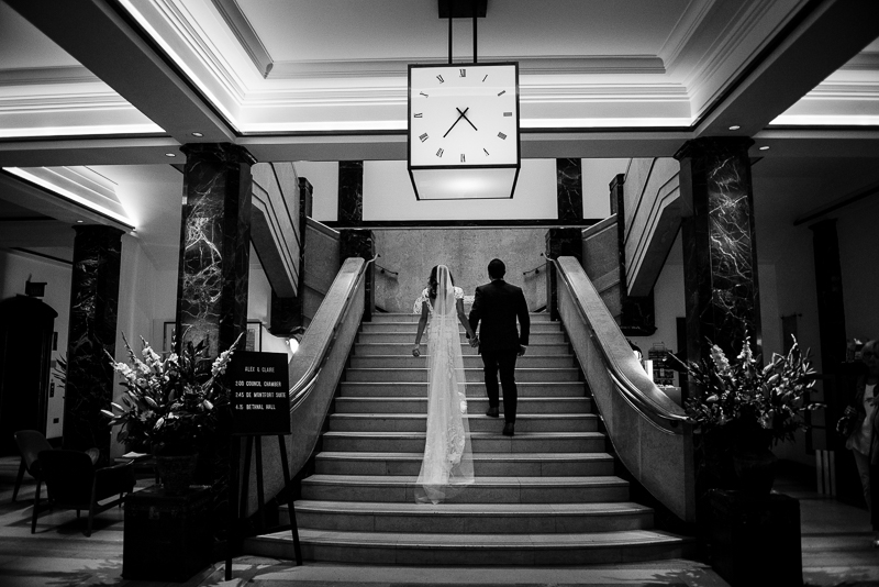 Bride and groom on stairs at Bethnal Green Town Hall Hotel