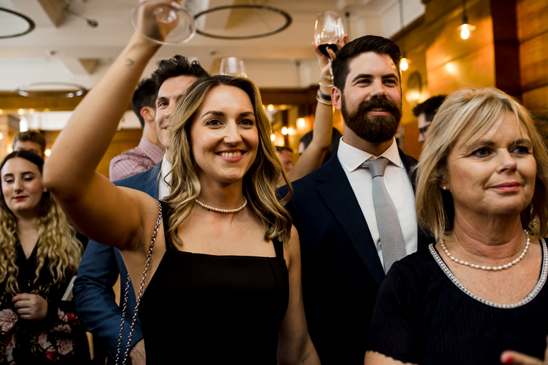 Guests cheer speeches at East London wedding