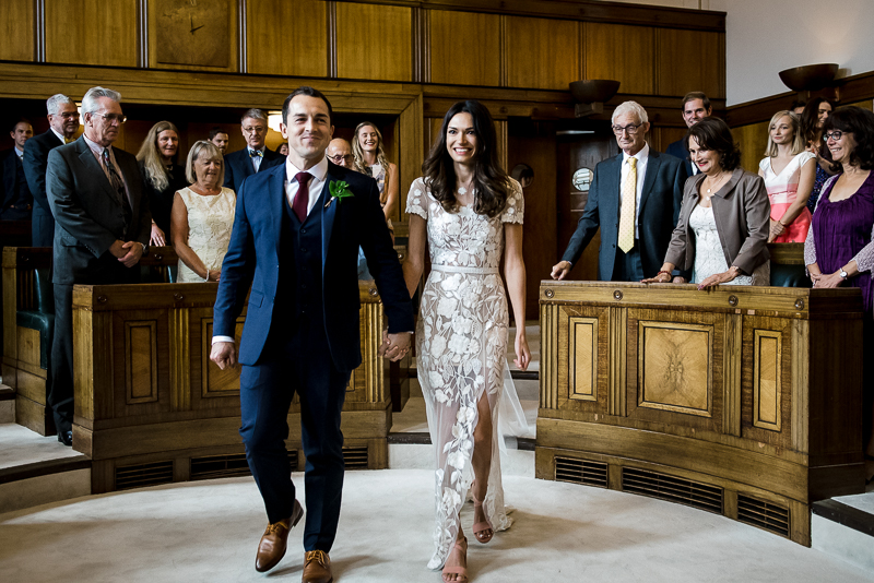 Bride and groom enter ceremony room for Town Hall Hotel wedding