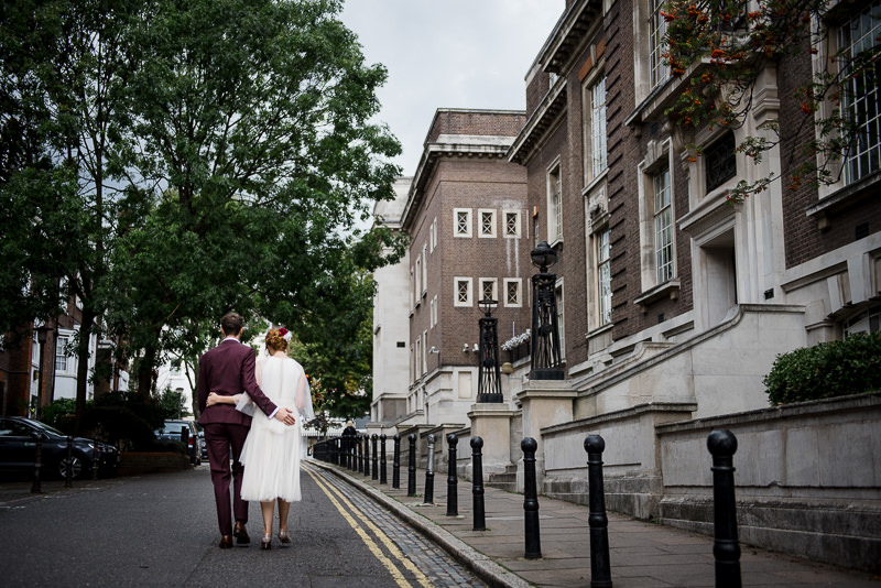 Bride and groom on the streets near Islington Town Hall